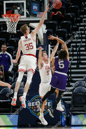 Branden Carlson, Jaxon Brenchley, Cody John. Utah's Branden Carlson (35) and Jaxon Brenchley (5) defend against Weber State guard Cody John (5) as he shoots in the second half during an NCAA college basketball game, in Salt Lake City