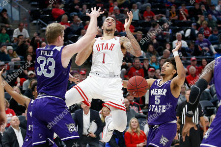 Tim Fuller, Cody John, Timmy Allen. Weber State's Tim Fuller (33) and Cody John (5) defend against Utah forward Timmy Allen (1) in the second half during an NCAA college basketball game, in Salt Lake City