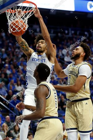 Kentucky's Nick Richards, top left, dunks near Georgia Tech's Moses Wright (5) and James Banks III during the first half of an NCAA college basketball game in Lexington, Ky