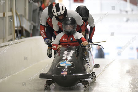 Stock Image of Geoffrey Gadbois, Chris Avery, Michael Fogt, Dakota Lynch. Driver Geoffrey Gadbois, Chris Avery, Michael Fogt, and brakeman Dakota Lynch, of the United States, start during the first run of the four-man bobsled World Cup race, in Lake Placid, N.Y., on