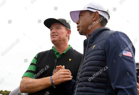 International team captain Ernie Els, left, shakes hands with U.S. team player and captain Tiger Woods after the U.S. team won the President's Cup golf tournament at Royal Melbourne Golf Club in Melbourne, . The U.S. team won the tournament 16-14