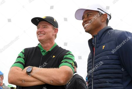 International team captain Ernie Els, left, talks with U.S. team player and captain Tiger Woods after the U.S. team won the President's Cup golf tournament at Royal Melbourne Golf Club in Melbourne, . The U.S. team won the tournament 16-14