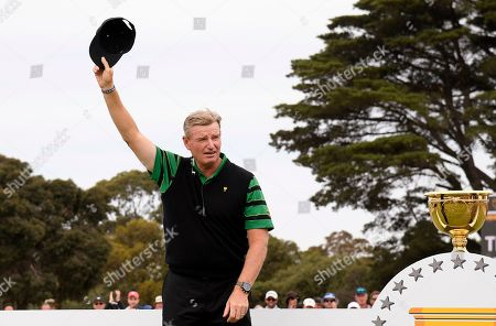 International team captain Ernie Els raises his hat during the presentation ceremony after the U.S. team won the President's Cup golf tournament at Royal Melbourne Golf Club in Melbourne, . The U.S. team won the tournament 16-14