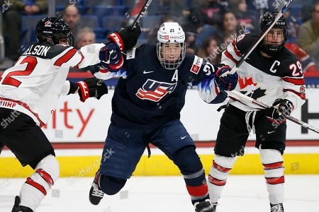 Stock Image of Hilary Knight, Meaghan Mikkelson, Marie-Philip Poulin. Canada's Meaghan Mikkelson (12) and Marie-Philip Poulin (29) defends against United States' Hilary Knight (21) during the third period of a rivalry series women's hockey game in Hartford, Conn