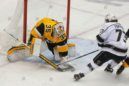 Pittsburgh Penguins goaltender Tristan Jarry (35) makes a save against Los Angeles Kings' Tyler Toffoli (73) during the first period of an NHL hockey game, in Pittsburgh