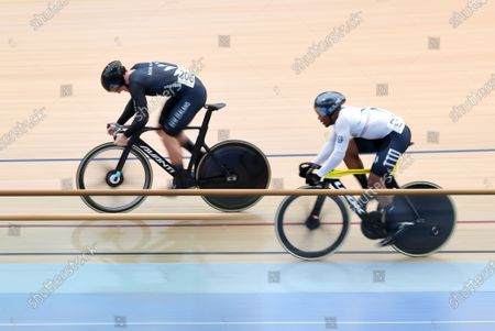 Stock Photo of Ethan Mitchell (L) of New Zealand races Paul Nicholas (R) of Trinidad and Tobago in the men's sprint event at the Tissot UCI Track Cycling World Cup at the Anna Meares Velodrome in Brisbane, Australia, 15 December 2019.