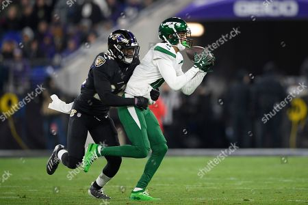 New York Jets wide receiver Robby Anderson (11) makes a catch against Baltimore Ravens cornerback Jimmy Smith (22) during the first half of an NFL football game, in Baltimore