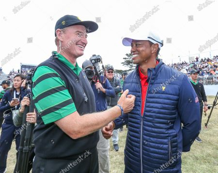 Playing Captain Tiger Woods (R) of the USA team and Captain Ernie Els (L) of the International team shake hands after the result during the Sunday singles matches on day four of the 2019 Presidents Cup golf tournament at the Royal Melbourne Golf Club in Melbourne, Australia, 15 December 2019.