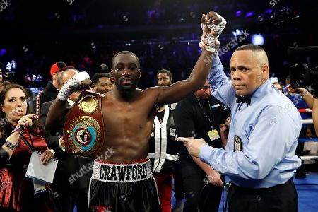 Stock Image of Terence Crawford has his hand raised in victory after defeating Lithuania's Egidijus Kavaliauskas by TKO in the ninth round of a WBO welterweight boxing match, in New York
