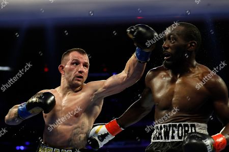 Lithuania's Egidijus Kavaliauskas, left, punches Terence Crawford during the fourth round of a WBO welterweight boxing match, in New York