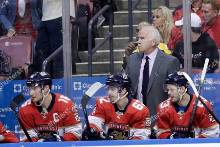 Florida Panthers head coach Joel Quenneville watches during the second period of an NHL hockey game against the Boston Bruins, in Sunrise, Fla