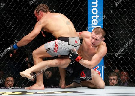 Petr Yan, right, fights Urijah Faber in a mixed martial arts bantamweight bout at UFC 245, in Las Vegas