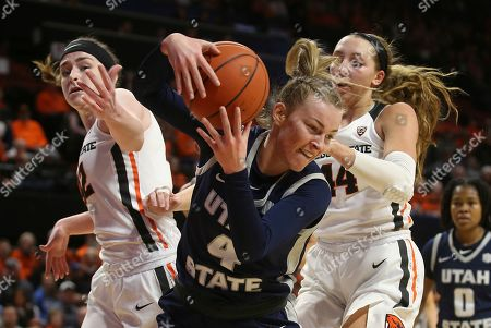 Utah State's Steph Gorman, center, battles Oregon State's Kennedy Brown, left, and Taylor Jones for a rebound during the first quarter of an NCAA college basketball game in Corvallis, Ore
