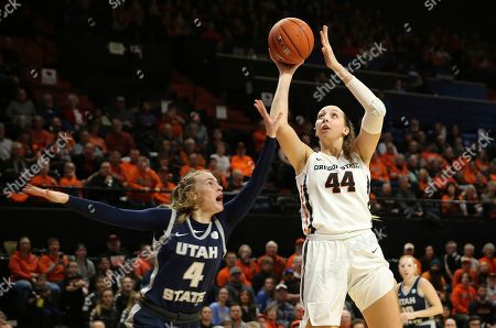Oregon State's Taylor Jones, right, shoots over Utah State's Steph Gorman during the first quarter of an NCAA college basketball game in Corvallis, Ore
