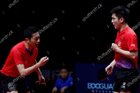 Xu Xin (L) and Fan Zhendong (R) of China react while in action against Liao Cheng-Ting and Lin Yun-Ju of Chinese Taipei during their Men's doubles finals match of the ITTF World Tour Grand Finals Table Tennis tournament in Zhengzhou, China, 15 December 2019.