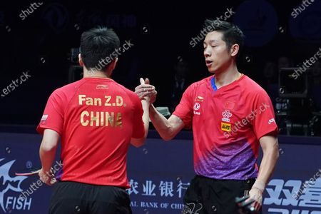 Fan Zhendong (L) and Xu Xin (R) of China react after they defeated Liao Cheng-Ting and Lin Yun-Ju of Chinese Taipei during their Men's doubles finals match of the ITTF World Tour Grand Finals Table Tennis tournament in Zhengzhou, China, 15 December 2019.