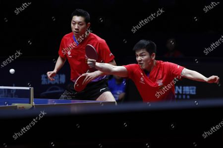 Xu Xin (L) and Fan Zhendong (R) of China in action against Liao Cheng-Ting and Lin Yun-Ju of Chinese Taipei during their Men's doubles finals match of the ITTF World Tour Grand Finals Table Tennis tournament in Zhengzhou, China, 15 December 2019.