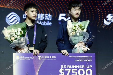Second place winners Liao Cheng-Ting (L) and Lin Yun-Ju (R) of Chinese Taipei stand on the podium at the award ceremony after they lost match to Xu Xin and Fan Zhendong of China at the conclusion of the Men's doubles finals match of the ITTF World Tour Grand Finals Table Tennis tournament in Zhengzhou, China, 15 December 2019.