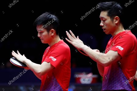 Xu Xin (R) and Fan Zhendong (L) of China in gesture while in action against Liao Cheng-Ting and Lin Yun-Ju of Chinese Taipei during the Men's doubles finals match of the ITTF World Tour Grand Finals Table Tennis tournament in Zhengzhou, China, 15 December 2019.