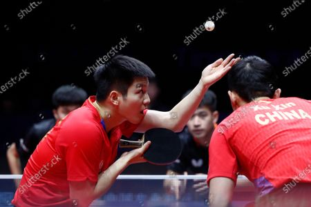 Xu Xin (R) and Fan Zhendong (L) of China in action against Liao Cheng-Ting and Lin Yun-Ju of Chinese Taipei during the Men's doubles finals match of the ITTF World Tour Grand Finals Table Tennis tournament in Zhengzhou, China, 15 December 2019.