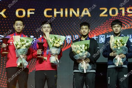 First place winners Xu Xin (L) and Fan Zhendong (2-L) of China and second place Liao Cheng-Ting (2-R) and Lin Yun-Ju (R) of Chinese Taipei attend the award ceremony at the conclusion of the Men's doubles finals match of the ITTF World Tour Grand Finals Table Tennis tournament in Zhengzhou, China, 15 December 2019.