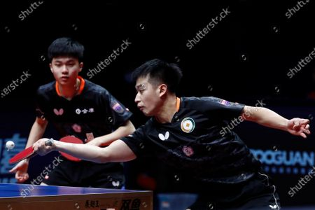 Liao Cheng-Ting (R) and Lin Yun-Ju (L) of Chinese Taipei in action against Xu Xin and Fan Zhendong of China during the Men's doubles finals match of the ITTF World Tour Grand Finals Table Tennis tournament in Zhengzhou, China, 15 December 2019.