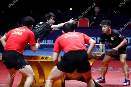 Stock Image of Liao Cheng-Ting (R) and Lin Yun-Ju (2-L) of Chinese Taipei in action against Xu Xin (2-R) and Fan Zhendong (L) of China during the Men's doubles finals match of the ITTF World Tour Grand Finals Table Tennis tournament in Zhengzhou, China, 15 December 2019.