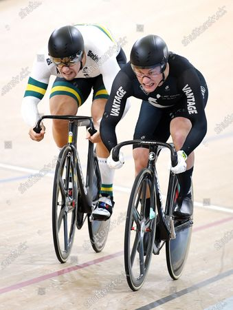 New Zealand's Sam Webster (R) shakes the hand of Australia's Matthew Glaetzer (L) race in the men's sprint semifinal event at the Anna Meares Velodrome in Brisbane, Australia, 15 December 2019.