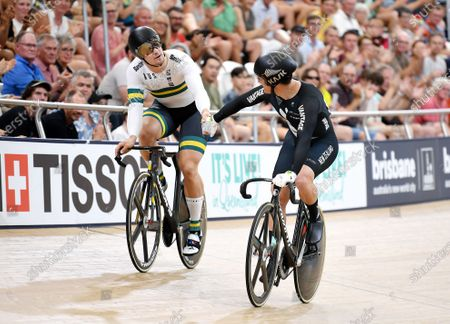 New Zealand's Sam Webster (R) shakes the hand of Australia's Matthew Glaetzer (L) after defeating him in the men's sprint semifinal event at the Anna Meares Velodrome in Brisbane, Australia, 15 December 2019.