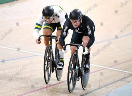 New Zealand's Sam Webster (R) and Australia's Matthew Glaetzer (L) race to the finish line in the men's sprint semifinal event at the Anna Meares Velodrome in Brisbane, Australia, 15 December 2019.