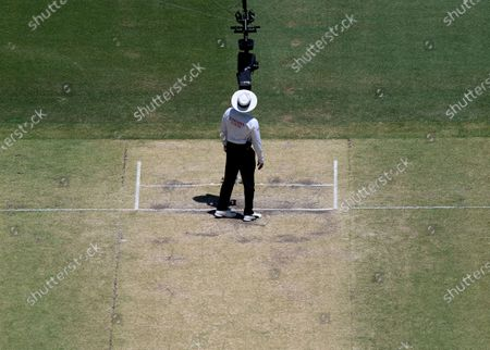 Umpire Aleem Dar looks into the spider-camera after inspecting the pitch prior to play on day four of the first Test match between Australia and New Zealand at Optus Stadium in Perth, Australia, 15 December 2019.