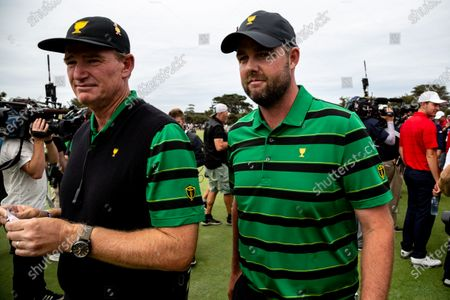 Ernie Els of South Africa and the International team and Marc Leishman of Australia and the International team after the final round of the 2019 Presidents Cup