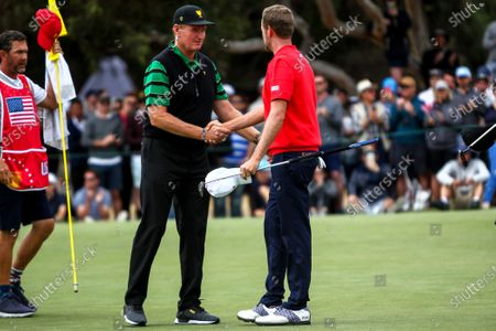 Ernie Els of South Africa and the International team congratulates Webb Simpson of the United States team