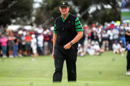 Ernie Els of South Africa and the International team walks up the 18th hole