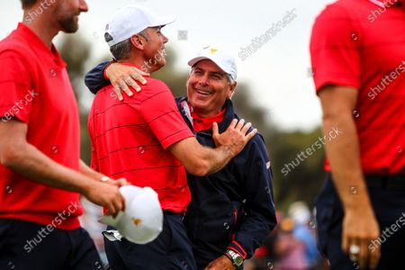 Fred Couples of the United States team celebrates with Matt Kuchar of the United States team after the final round of the 2019 Presidents Cup