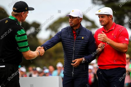 Tiger Woods of the United States team shakes hands with Ernie Els of South Africa and the International team during the presentation ceremony of the 2019 Presidents Cup