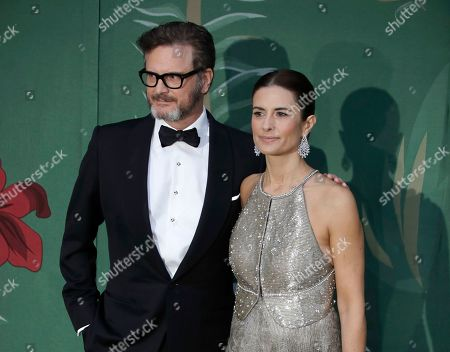 Colin Firth, Livia Giuggioli. Dated, British actor Colin Firth and his wife Livia, pose for photographers upon arrival at the Green Carpet Fashion Awards in Milan, Italy. A statement from their publicists says Colin and Italian eco-campaigner and film producer Livia Firth have separated after 22-years of marriage