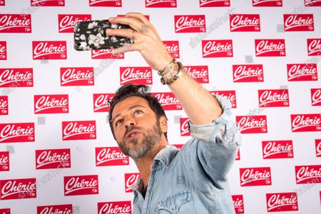 Christophe Mae poses for photograph