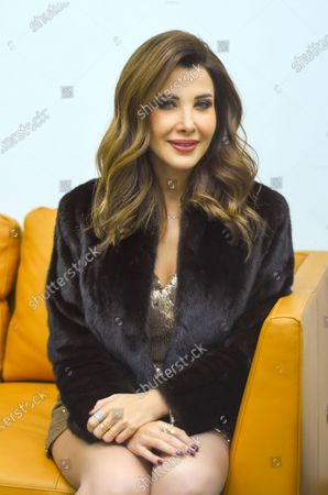 Nancy Ajram poses for a photograph before performing at the Annual charity concert hosted by the German University in Cairo, Egypt, 14 December 2019 (issued 15 December 2019).