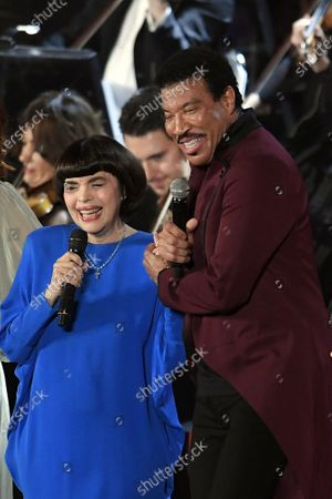 Mireille Mathieu and Lionel Richie perform in the Paul VI Hall at the Vatican during the Christmas concert