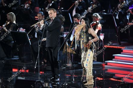 Andrea Griminelli and Leo Rojas perform in the Paul VI Hall at the Vatican during the Christmas concert