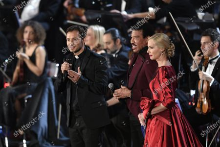 Don Davide Banzato, Lionel Richie and Federica Panicucci perform in the Paul VI Hall at the Vatican during the Christmas concert