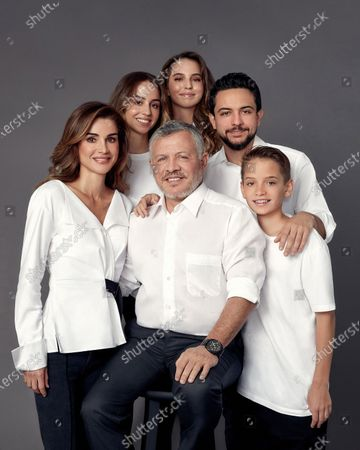 Stock Picture of King Abdullah II and Queen Rania and Their Royal Highnesses Crown Prince Al Hussein, Prince Hashem, Princess Iman, and Princess Lalla Salma in this year's holiday greeting photo