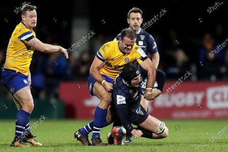 ASM Clermont Auvergne vs Bath Rugby. Clermont's Arthur Iturria is tackled by Jamie Roberts of Bath