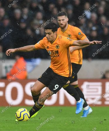 Wolverhampton Wanderers' Raul Jimenez (L) in action during the English Premier League soccer match between Wolverhampton Wanderers  and Tottenham Hotspur at Molineux Stadium in Wolverhampton, Britain, 15 December 2019.