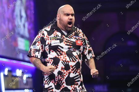 Kyle Anderson wins his first round match against Xiaochen Zong and celebrates during the PDC William Hill World Darts Championship at Alexandra Palace, London