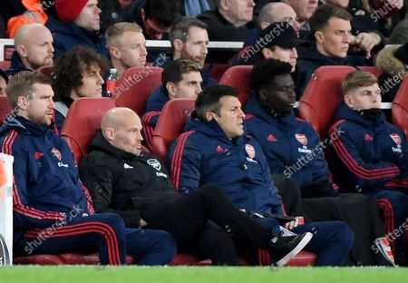 Arsenal's interim manager Freddie Ljungberg (2-L) sits on the bench with assistant coach Per Mertesacker (L) during the English Premier league soccer match between Arsenal FC and Manchester City at Emirates stadium in London, Britain, 15 December 2019.
