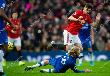 Everton's Tom Davies (bottom) in action with Manchester United's Daniel James (top) during the English Premier League soccer match between Manchester United and Everton held at the Old Trafford in Manchester, Britain, 15 December 2019.