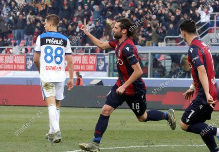 Bologna's Andrea Poli (C) celebrates after scoring during the Italian Serie A soccer match Bologna Fc vs Atalanta at the Renato Dall'Ara stadium in Bologna, Italy, 15 December 2019.