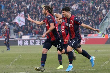 Bologna's Andrea Poli (L) celebrates after scoring during the Italian Serie A soccer match Bologna Fc vs Atalanta at the Renato Dall'Ara stadium in Bologna, Italy, 15 December 2019.